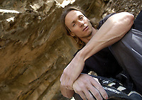 Professional rock climber Timmy Fairfield (CQ) climbs at a bouldering location named Sheng Dian in Las Huertas Canyon, Monday, Oct. 18, 2004...PHOTOS/ MATT NAGER