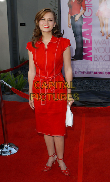 BETHANY JOY LENZ.Attending the world premiere of Mean Girls at the Cinerama Dome, Hollywood, California..April 19th 2004.full length full-lenghth red cap sleeved knee length dress belted strappy heels.*UK sales only*.www.capitalpictures.com.sales@capitalpictures.com.©Capital Pictures