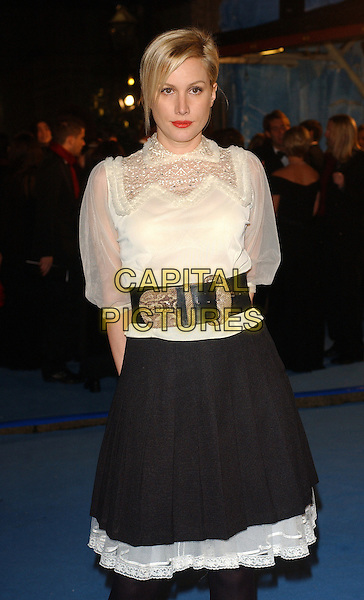 "ALICE EVANS.World Premiere of"" The Chronicles of Narnia: The Lion The Witch and The Wardrobe"" held at the Royal Albert Hall, London, UK..December 7th, 2005.Ref: BEL.half length wide black belt white sheer blouse skirt.www.capitalpictures.com.sales@capitalpictures.com.© Capital Pictures."