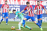 Leo Messi of Futbol Club Barcelona -competes for the ball with Gabi Fernandez of Atletico de Madrid  during the match of Spanish La Liga between Atletico de Madrid and Futbol Club Barcelona at Vicente Calderon Stadium in Madrid, Spain. February 26, 2017. (ALTERPHOTOS)