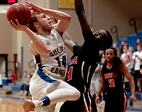 Photo courtesy of John Brown University<br /> Siloam Springs senior Jake Caudle takes a shot in the second half Saturday against Mid-America Christian. Caudle scored 19 points but the Evangels defeated the Golden Eagles 71-66.