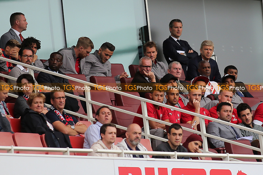 Arsenal Manager, Arsene Wenger, watches the match surrounded by members of his team during RB Leipzig vs Sevilla, 2017 Emirates Cup Football at the Emirates Stadium on 29th July 2017