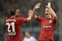 FUSSBALL   1. BUNDESLIGA   SAISON 2012/2013    34. SPIELTAG Hamburger SV - Bayer 04 Leverkusen                      18.05.2013 Oemer Toprak (li) und Philipp Wollscheid (re, beide Bayer 04 Leverkusen) jubeln nach dem Abpfiff