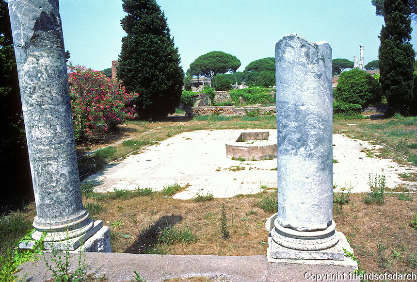 """Italy: Ostia--The Market. Pillar on right bears inscription, """"Read this and know that gossip is rife in the market."""" Photo '83."""