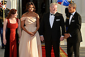 U.S. President Barack Obama (R) and First Lady Michelle Obama (2nd,L) welcome Iceland's Prime Minister Sigurdur Ingi Johannson (2nd,R) and his spouse Ingibjorg Elsa Ingjaldsdottir, at the White House, for a State Dinner for the Nordic leaders, May 13, 2016, in Washington, DC.       <br /> Credit: Mike Theiler / Pool via CNP