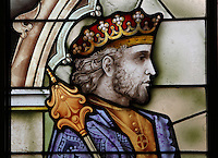 Stained glass window showing King Alfonso VI (1040-1109), the Alcazar of Segovia, 12-16th centuries, Segovia, Spain. First mentioned in 1122 when Segovia was reconquered by Alfonso VI, the castle was updated in the 13th, 15th and 16th centuries, and the interior was restored in the 19th century. Picture by Manuel Cohen