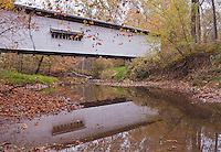 The Portland Covered Bridge is surrounded by autumn color in Parke County, Indiana