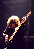Black Sabbath - bassist Geezer Butler - performing live at the first reunion concert of the original line-up at the NEC Arena in Birmingham UK - 04 Dec 1997.  Photo credit: George Chin/IconicPix