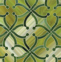 June, a water jet jewel glass mosiac, shown in Aventurine and Peridot is part of the Ann Sacks Beau Monde collection sold exclusively at www.annsacks.com