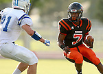 SIOUX FALLS, SD - SEPTEMBER 19: Rasheed Benton #7 from Washington looks to make a move past Jeremy Schick #21 from Rapid City Stevens in the first quarter of their game Friday night at Howard Wood Field.  (Photo by Dave Eggen/Inertia)