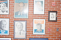 Old campaign posters hang on the walls of the New Hampshire Institute of Politics at Saint Anselm College in Manchester, New Hampshire.