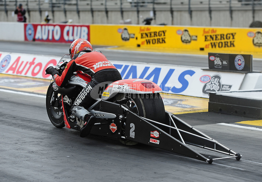 Nov. 10, 2011; Pomona, CA, USA; NHRA pro stock motorcycle rider Andrew Hines during qualifying at the Auto Club Finals at Auto Club Raceway at Pomona. Mandatory Credit: Mark J. Rebilas-.