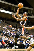 January 9, 2009:   Mercer guard James Florence (0) goes up for a layup in Atlantic Sun Conference action between the Jacksonville Dolphins and the Mercer Bears at Veterans Memorial Arena in Jacksonville, Florida.  Jacksonville defeated Mercer 80-59.