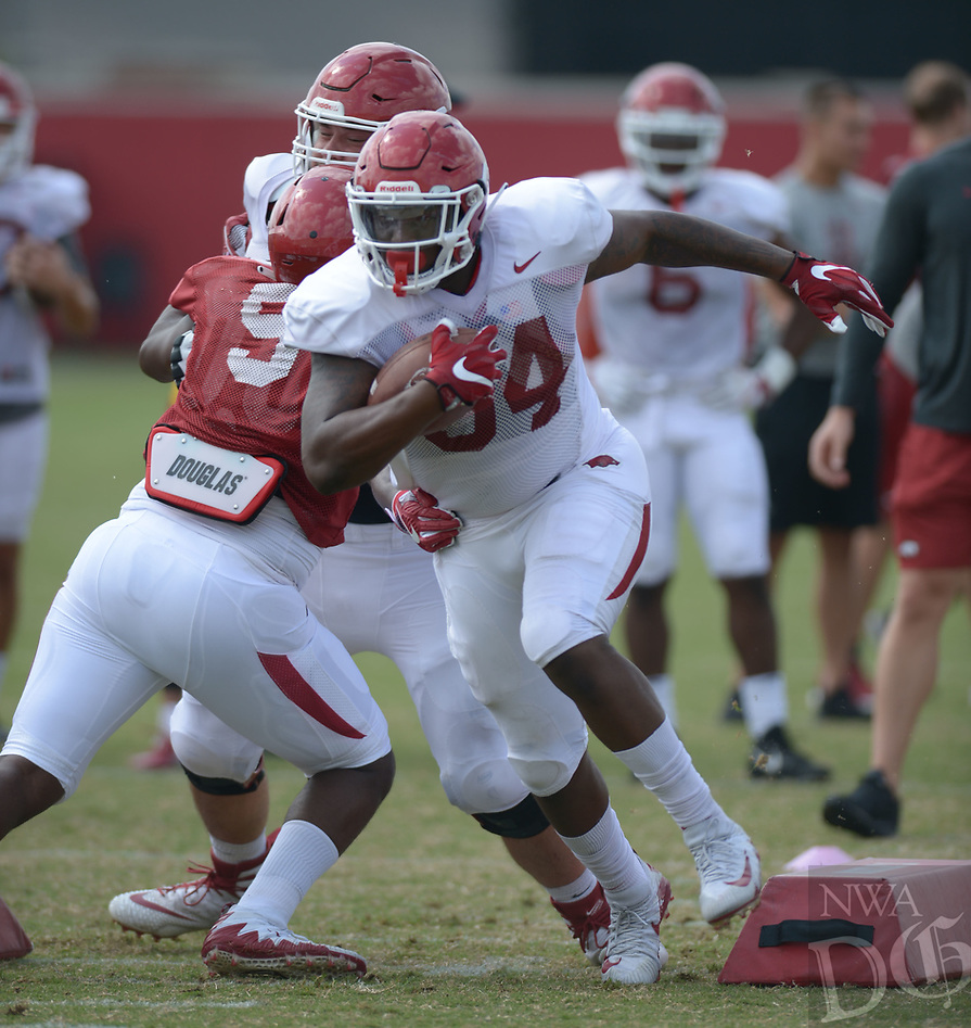 NWA Democrat-Gazette/ANDY SHUPE<br /> Arkansas fullback Kendrick Jackson carries the ball Thursday, Aug. 9, 2018, during practice at the university's practice facility in Fayetteville. Visit nwadg.com/photos to see more photos from practice.