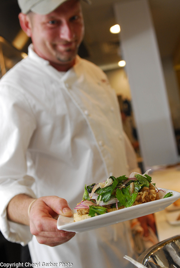 Chef Donald Link serves fried chicken livers with style at Cochon, a hot new restaurant in New Orleans, May 4, 2006..(Cheryl Gerber for New York Times)..