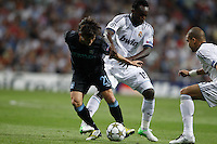 17.09.2012 SPAIN -  Champions League 12/13 Matchday 1th  match played between Real Madrid CF vs  Manchester City at Santiago Bernabeu stadium. The picture show Michale Essien (Ghana midfieldes of Real Madrid) and David Silva (Midfielders of Manchester City)