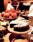 USA, California, Berkeley, chocolate cake with peaches in kitchen, Chez Panisse
