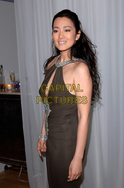 "GONG LI.""Miami Vice"" afterparty at the Sanderson Hotel, London, UK..July 27th, 2006.Ref: FIN.after party half length green brown halterneck dress.www.capitalpictures.com.sales@capitalpictures.com.©Steve Finn/Capital Pictures."