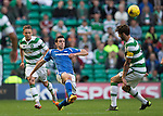 Celtic v St Johnstone...29.08.15  SPFL   Celtic Park<br /> Joe Shaughnessy clears from Charlie Mulgrew<br /> Picture by Graeme Hart.<br /> Copyright Perthshire Picture Agency<br /> Tel: 01738 623350  Mobile: 07990 594431