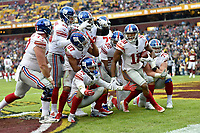 Giants WR Bennie Fowler III (18) celebrates after his touchdown catch by taking a group photo with all of his offensive teammates: Spencer Pulley (77), Eli Manning (10), Sterling Shepard (87), Jamon Brown (78), Russell Shepard (81), Will Hernandez (71), Wayne Gallman, Jr. (22), Chad Wheeler (63), and Nate Solder (76) in the end zone during the New York Giants vs. the Washington Redskins on December 9, 2018 at FedEx Field in Landover, MD.
