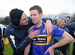 Newmarket player Shane O Brien is congratulated by tea mentor Pat Freeman following their win over Sixmilebridge in the Clare Champion Cup final at Clonlara. Photograph by John Kelly.