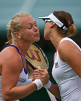 24-06-13, England, London,  AELTC, Wimbledon, Tennis, Wimbledon 2013, Day one, Yaroslava Shvedova (KAZ) is congretulated bij Kiki Bertens(L)<br /> <br /> <br /> <br /> Photo: Henk Koster
