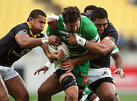 David Smith and Matthew Luamanu try to stop Manawatu number eight Brent Thompson. Air NZ Cup - Wellington Lions v Manawatu Turbos at Westpac Stadium, Wellington, New Zealand. Saturday 3 October 2009. Photo: Dave Lintott / lintottphoto.co.nz