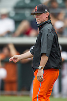 Oklahoma State Cowboys pitching coach Rob Walton calls for a relief pitcher during the NCAA baseball game against the Texas Longhorns on April 26, 2014 at UFCU Disch–Falk Field in Austin, Texas. The Cowboys defeated the Longhorns 2-1. (Andrew Woolley/Four Seam Images)