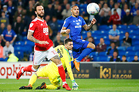 Kenneth Zohore of Cardiff City chips keeper Stefanos Kapino of Nottingham Forest only for is shot to be cleared off the line during the Sky Bet Championship match between Cardiff City and Nottingham Forest at the Cardiff City Stadium, Wales, UK. Saturday 21 April 2018