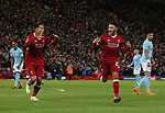 Alex Oxlade-Chamberlain of Liverpool (r) celebrates his goal with Roberto Firmino of Liverpool during the Champions League Quarter Final 1st Leg, match at Anfield Stadium, Liverpool. Picture date: 4th April 2018. Picture credit should read: Simon Bellis/Sportimage