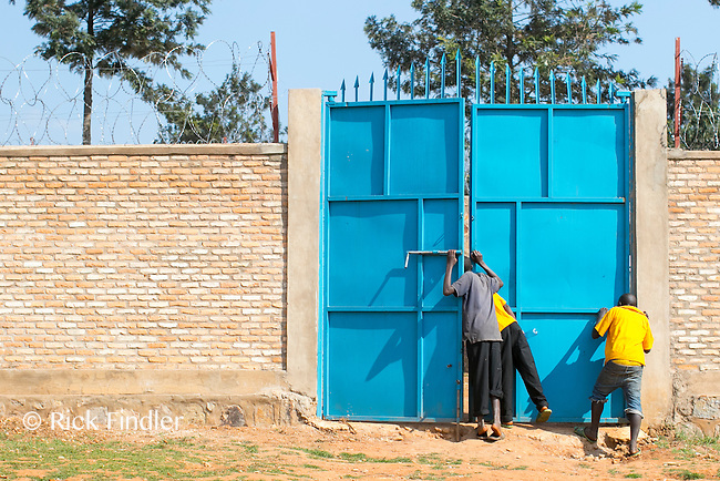 BURUNDI, Ruyigi: 10 June 2015 Ruyigi Re-education Centre Feature.<br /> See accompanying article for general information. <br /> Pictured: Inmates tentatively peak through one of the gates on the inner wall of the centre. <br /> Rick Findler / Story Picture Agency