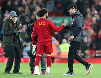 27th October 2019; Anfield, Liverpool, Merseyside, England; English Premier League Football, Liverpool versus Tottenham Hotspur; Liverpool manager Jurgen Klopp shakes hands with Mohammed Salah of Liverpool after the final whistle  - Strictly Editorial Use Only. No use with unauthorized audio, video, data, fixture lists, club/league logos or 'live' services. Online in-match use limited to 120 images, no video emulation. No use in betting, games or single club/league/player publications