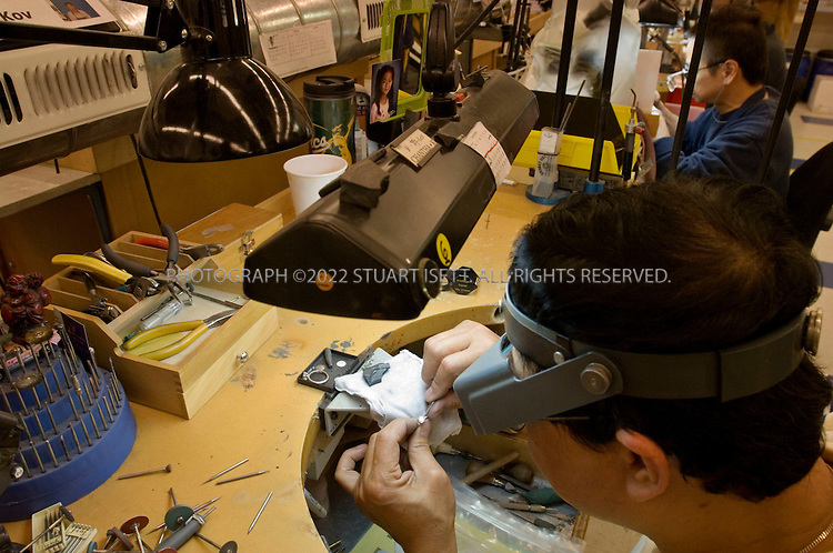 12/12/2006--Seattle, WA, USA..Workers polish and mount diamonds at Blue Nile's workshop in Seattle, WA. Blue Nile (www.bluenile.com) sells expensive diamonds online from its base in Seattle...Photograph By Stuart Isett.All photographs ©2006 Stuart Isett.All rights reserved.