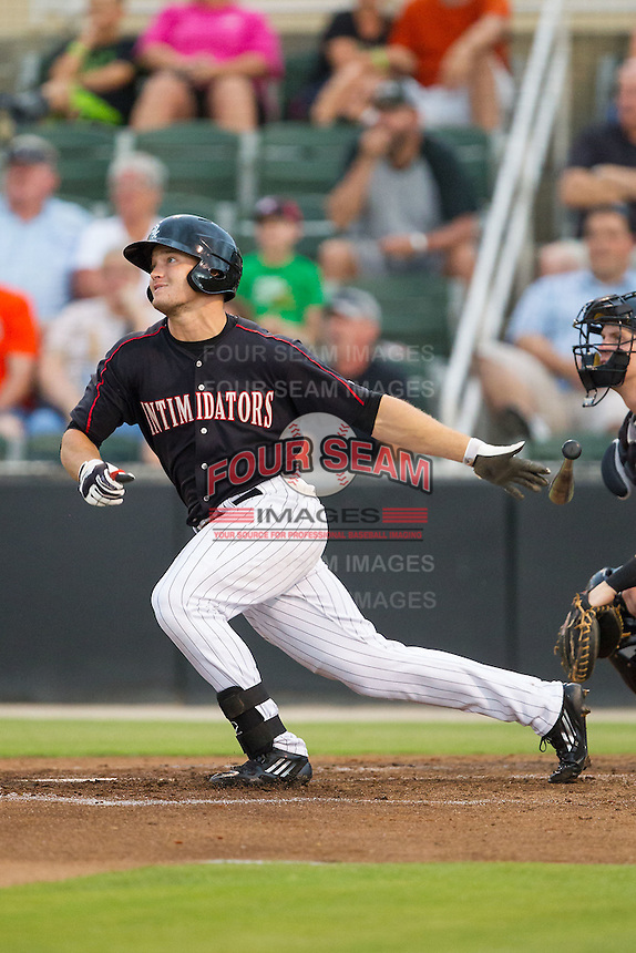 Adam Engel (23) of the Kannapolis Intimidators follows through on his swing against the Delmarva Shorebirds at CMC-NorthEast Stadium on July 3, 2014 in Kannapolis, North Carolina.  The Shorebirds defeated the Intimidators 6-5. (Brian Westerholt/Four Seam Images)