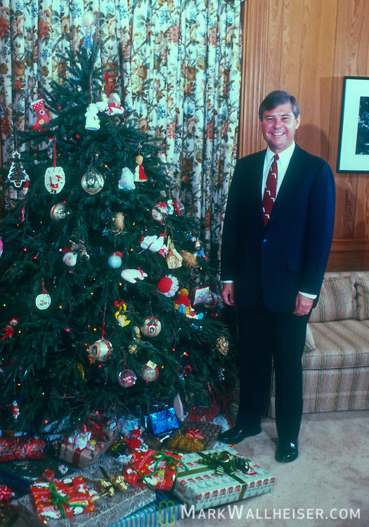 Photograph of Florida governor Bob Graham stands next to his family's Christmas Tree in the Governor's mansion in Tallahassee, Florida December 20, 1984,