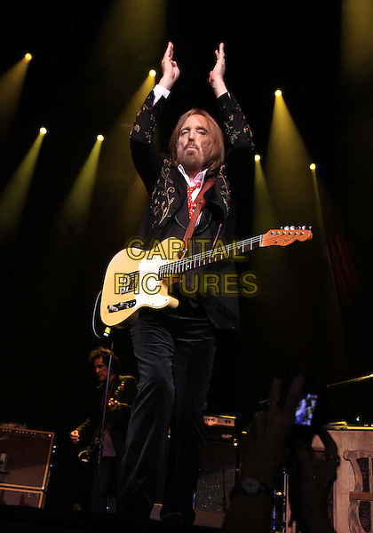 Tom Petty.Superstar rocker Tom Petty brough his tour to the Verizon Wireless Amphitheater in Alpharett, GA, where he performed his hits for a sold-out crowd of enthusiastic fans, Alpharetta, GA., USA..April 29th, 2012.on stage in concert live gig performance performing music full length black suit beard facial hair guitar hands arms in air.CAP/ADM/DH.©Dan Harr/AdMedia/Capital Pictures.