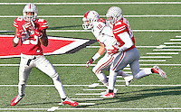 Ohio State Buckeyes safety Tyvis Powell (23) intercepts a ball meant for Indiana Hoosiers wide receiver Simmie Cobbs (10) late in the fourth quarter at Ohio Stadium on 22, 2014. Ohio State Buckeyes cornerback Doran Grant (12) provided defense on the play as well.  (Chris Russell/Dispatch Photo)