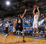 BROOKINGS, SD - OCTOBER 30:  Anders Broman #5 from South Dakota State University shoots a three pointer over Kendall Waters #4 from South Dakota School of Mines in the first half of their exhibition game Thursday night at Frost Arena in Brookings. (Photo by Dave Eggen/Inertia)