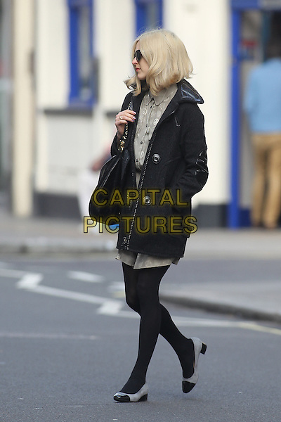 Fearne Cotton in central London, England..March 2nd, 2012.full length black tights jacket coat beige dress bag purse sunglasses shades hand in pocket side profile .CAP/HIL.©John Hillcoat/Capital Pictures .