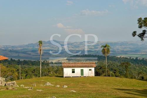 Fazenda Bauplatz, Brazil. Typical old wooden fazenda building with a view over a broad valley.