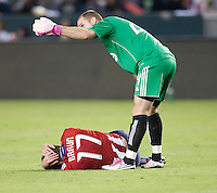 CARSON, CA – OCTOBER 9: Toronto FC goalie Stefan Frei (24) and Chivas USA forward Justin Braun (17) during a soccer match at Home Depot Center, October 9, 2010 in Carson California. Final score Chivas USA 3, Toronto FC 0...