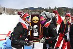 FRANCONIA, NH - MARCH 11:   The University of Utah ski team members kiss the championship trophy and celebrate their first place finish in the Division I Men's and Women's Skiing Championships held at Jackson Ski Touring on March 11, 2017 in Jackson, New Hampshire. (Photo by Gil Talbot/NCAA Photos via Getty Images)