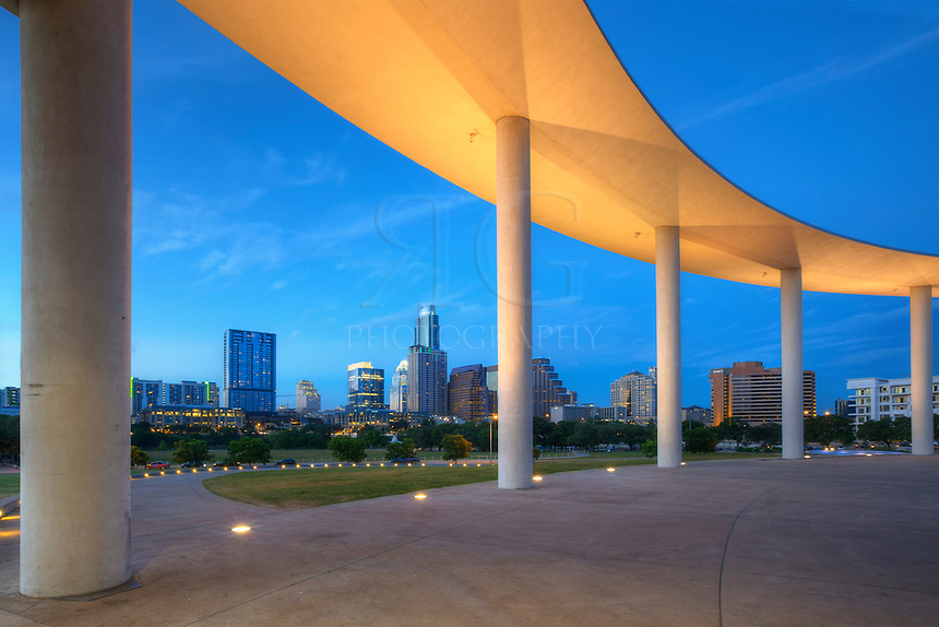 From the pavillion of the Long Center, this angle looks through the columns towards downtown Austin, Texas, and the evening skyline.
