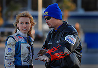 Jan 21, 2007; Las Vegas, NV, USA; NHRA Super Comp driver Courtney Force receives advice from Top Fuel Dragster driver Jack Beckman during preseason testing at The Strip at Las Vegas Motor Speedway in Las Vegas, NV. Mandatory Credit: Mark J. Rebilas