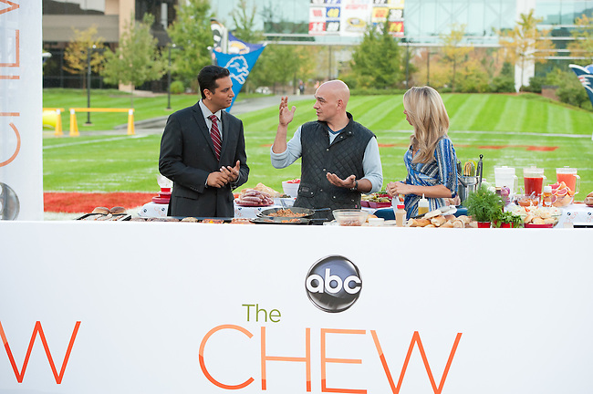 "October  14, 2011 - Bristol, CT - Campus Green: ABC's ""The Chew"" Chef Michael Symon with SportsCenter anchors Sara Walsh and Kevin Negandhi..Credit: Joe Faraoni"