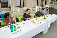 Judges from left: Venitia Boyce '19; Courtney Robertson, Corporate & Foundation Relations; Brad Kent, chef and John Lang, associate professor, sociology.<br /> Six student teams battle to win the Iron Chef competition as part of Earth Month on Thursday, April 11, 2019 in the JSC Quad. Event MC, Amos Himmelstein, provided play-by-play of the action. Their task was to create the best vegetarian or vegan starter and sauté dishes. A wide variety of fresh organic produce (some freshly picked at the FEAST garden), FEAST eggs, spices, oils AND one secret ingredient were at the team's disposal.<br /> Chef Brad Kent, owner of Olio GCM Wood Fired Pizzeria at Grand Central Market and co-Founder/chief culinary officer for Blaze Pizza, is this year's guest judge.<br /> The contest is led by FEAST and supported by Campus Dining, Facilities Management, RESF, and the Office of the President.<br /> (Photo by Marc Campos, Occidental College Photographer)