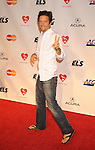 LOS ANGELES, CA. - January 29: Jason Mraz arrives at the 2010 MusiCares Person Of The Year Tribute To Neil Young at the Los Angeles Convention Center on January 29, 2010 in Los Angeles, California.