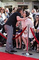 HOLLYWOOD, CA - APRIL 12: Billy Crystal, Janice Crystal, at 2019 10th Annual TCM Classic Film Festival - Hand and Footprint Ceremony: Billy Crystal at the TCL Chinese Theatre IMAX on April 12, 2019. <br /> CAP/MPI/FS<br /> ©FS/MPI/Capital Pictures