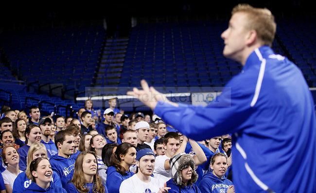 Fans watch as pre-pharmacy junior Ross Turner, also known as the Wildcat, leads chants at the cheer practice at Rupp Arena on Wenesday evening. Photo by Zach Brake | Staff