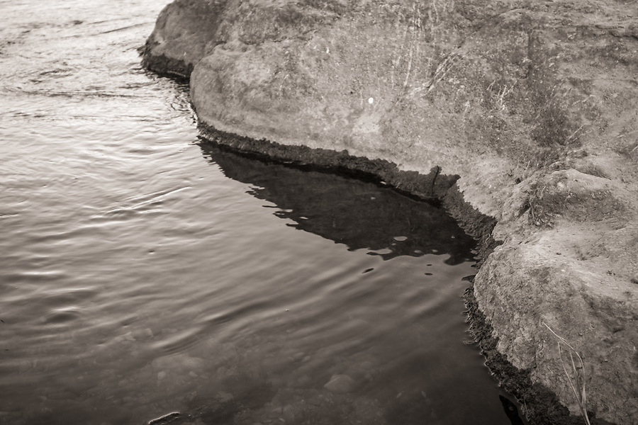 Black and white photo of limestone rocks in the Pedernales River at Pedernales Falls State Park, Johnson City, Texas.
